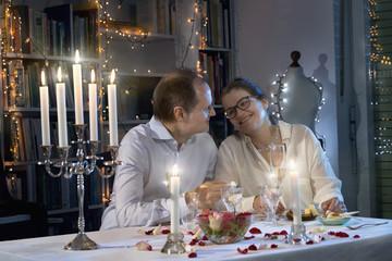 Romantic couple enjoying a candlelight dinner