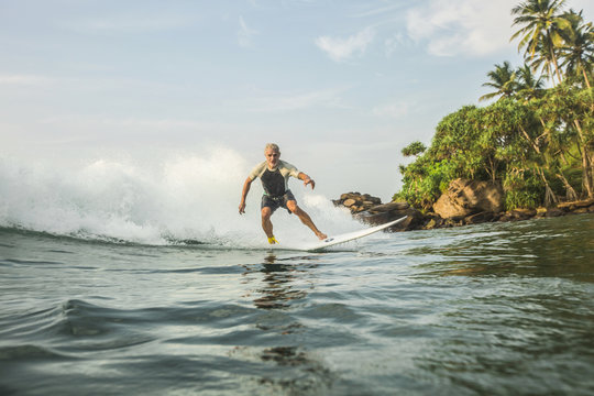 Man surfboarding in the Indian ocean, Sri Lanka