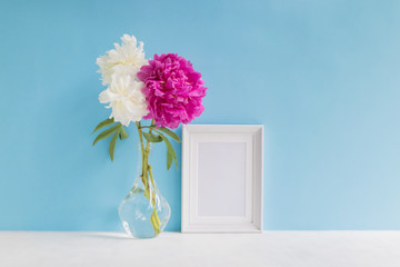 Mockup with a white frame and white and pink peonies