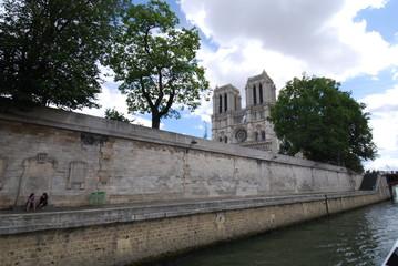 Notre Dame de Paris; waterway; tree; canal; sky