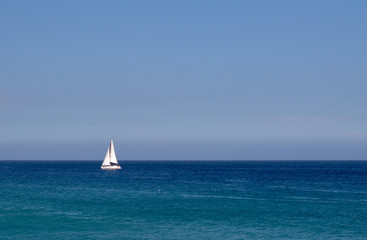 Sailing in the open blue ocean and sky in Mexico