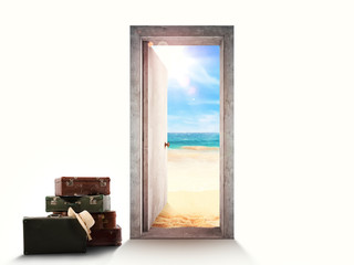 Door on white background leading to the beach with luggage on the floor.