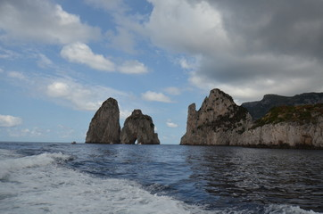 Faraglioni; sea; coast; coastal and oceanic landforms; sky