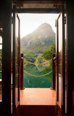 Sunset view through a boat door over a lake in China