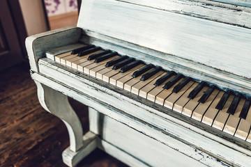 vintage white piano