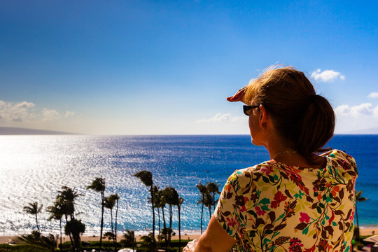 Woman looking for whales on Maui