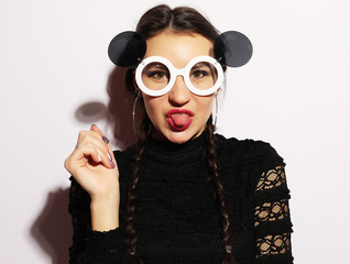 Fashion concept. Beauty surprised fashion model girl wearing big sunglasses. Young girl. Makeup.