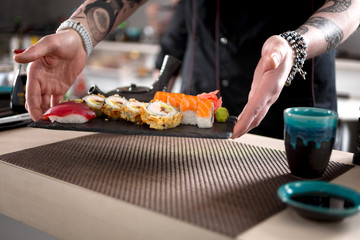 preparing sushi in Japanese restaurant