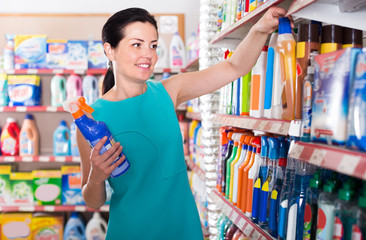 Pretty female want to buying cleaners in bottle