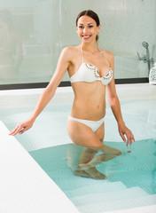 Girl in bikini posing in hot tub