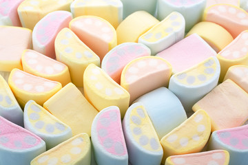 Pastel colors background of colorful Marshmallows in crescent shape.
