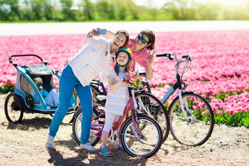 Family on bike in tulip flower fields, Holland