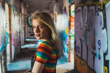Rebel girl among bright graffiti