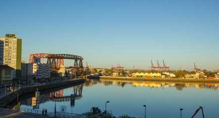 Panorama of the industrial part of La Boca, with cranes of the port and the bridge of Avellaneda in the background. Buenos Aires, Argentina