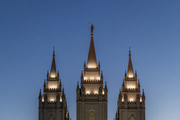 Poster Temple The Angel Moroni and spires of Salt Lake Temple at sunset in springtime. The Church of Jesus Christ of Latter-day Saints, Temple Square, Salt Lake City, Utah, USA.