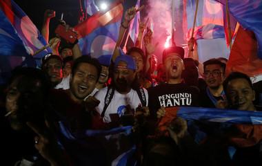 Supporters of Mahathir Mohamad celebrate in Petaling Jaya