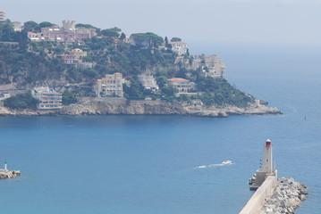 Promenade des Anglais; Port of Nice; sea; coast; coastal and oceanic landforms; sky