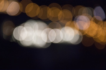 Blured city lights in warm orange and white colors of munich in bavaria unfocused