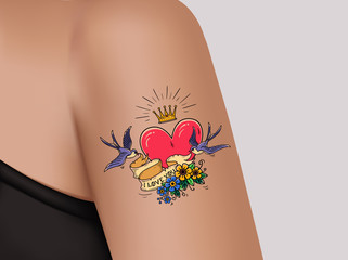 Tattoo on shoulder.Pink heart and gold crown.Two swallows fly and hold ribbon decorated with flowers.Template for banner