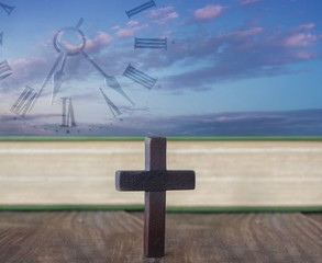 Cross on table . Religion background .  Paradise heaven  . The Cross of Jesus Christ and beautiful clouds .  Time passing  . Sunset over the field . Sunrise .