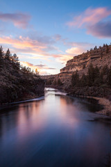 The waters of the Crooked River flows through a canyon at sunset in Central Oregon