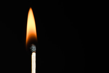 The match on fire on black background close-up