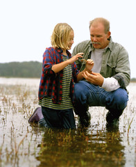Father and daughter in marshland