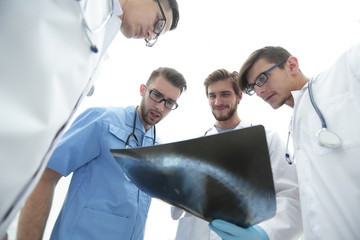 bottom view.team of doctors discussing an x-ray