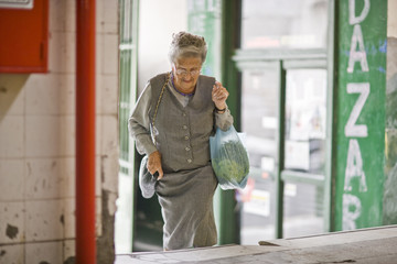 Senior adult woman leaving after grocery shopping.