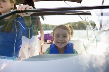 Young boy and his family on a boat.