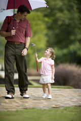 Father and daughter on golf course
