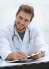 background image of a doctor writing out a prescription