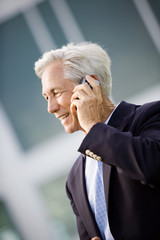 Mature businessman talking on a cell phone.