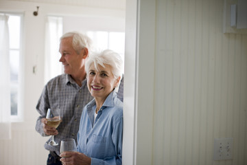 Portrait of a senior woman drinking wine with her husband.