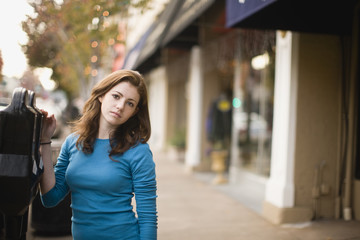 Portrait of girl standing next to parking meter