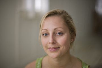 Portrait of young adult woman in a room.
