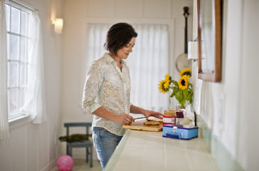 Mid adult woman preparing lunch in a kitchen.