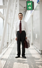 Portrait of businessman standing at an airport.