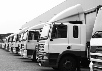 lorries parked up outside a company's car parking area ready to deliver goods to customers stock photo