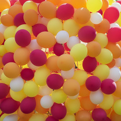 Abstract background of balloons in golden orange-red colors. Festive concept with texture