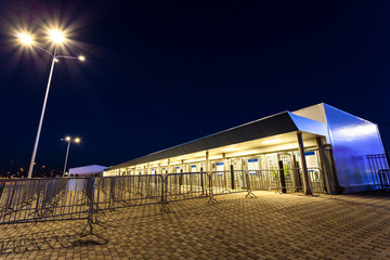 ticket office in front of the stadium at night