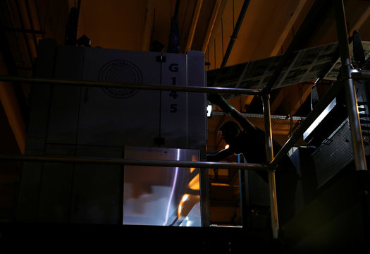 A worker prepares for the printing of the daily newspaper Times of Malta on a web offset printing machine at Progress Press in Mriehel