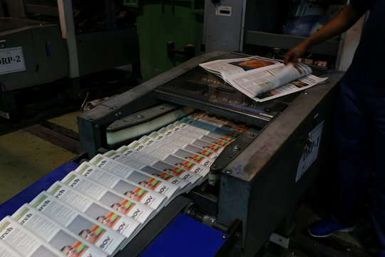 A worker monitors the print quality of the daily newspaper Times of Malta as it is printed on a web offset printing machine at Progress Press in Mriehel