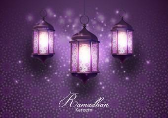 Ramadan Kareem greetings card with Lanterns hanging in a dark glowing background