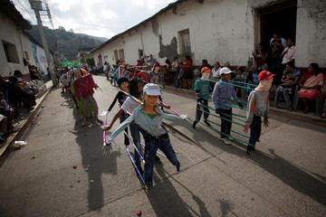 Children perform during a parade to celebrate Mother's Day in Chilapa de Alvarez