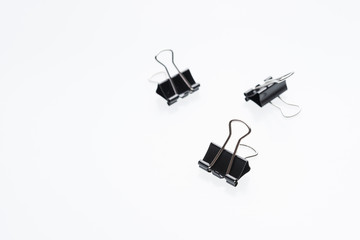 Binder clips for paper on a white background