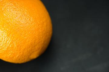 orange, isolated orange on a black background. Top view