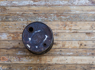 iron industrial barrel on a wooden background