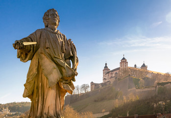 Marienberg Fortress in Wurzburg with statue on the foreground, Germany