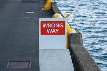 """""""WRONG WAY"""" Sign On Wharf"""